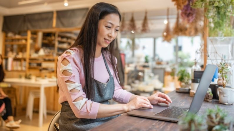 A business owner connecting with other retailers online